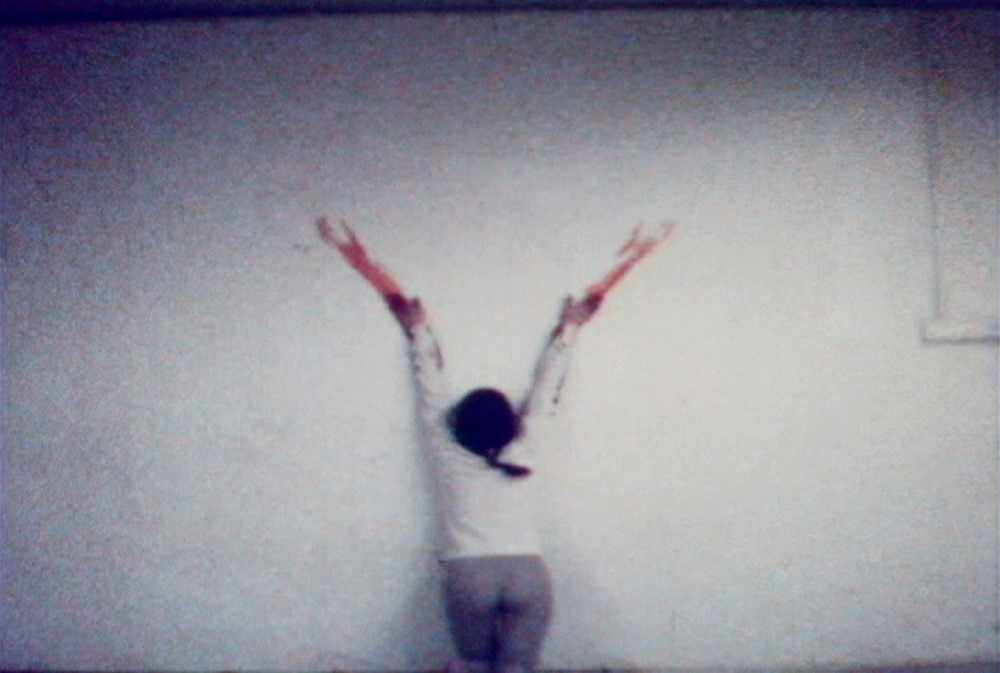 Figure 3 - Ana Mendieta, Untitled Body Tracks (Blood Sign #2) 1974. Video still, 1 min, color, sound. [http://www.canadianart.ca/reviews/2011/07/21/ana_mendieta/]