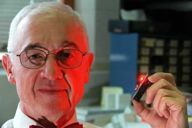 Figure 7 – Scientist Nick Holoniack Jr. with your creation, the red LED. Source: http://news.illinois.edu/ii/12/1018/LED_at_50_Nick_Holonyal_Jr.html (2010)